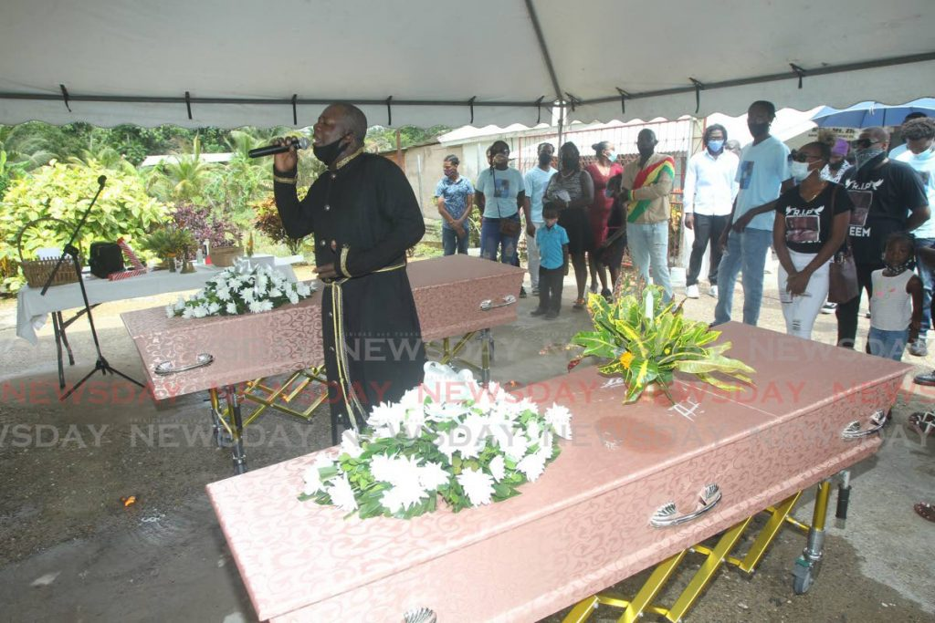 Baptist deacon  Richard Rivers officiated at the funeral service for Hakim Simms and his father, Alvin Marlon Simms who were gunned down in Moruga. - Photo by  Lincoln Holder