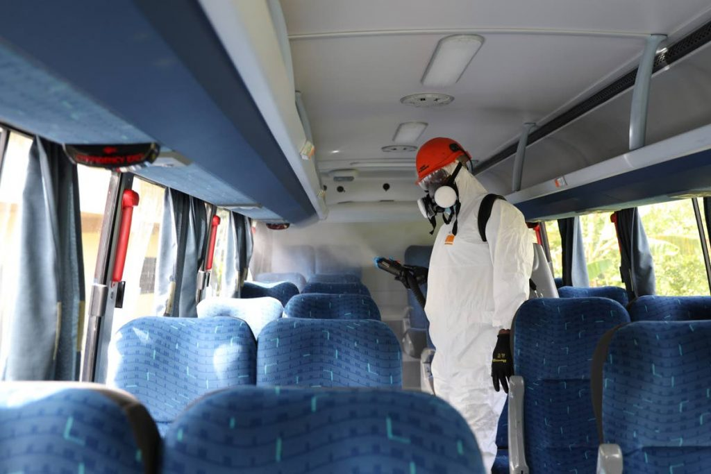 Safe Travels stamp holder Transmax Transportation Corporation conducts a sanitisation exercise in one of its buses. Photo courtesy Tobago Tourism Agency