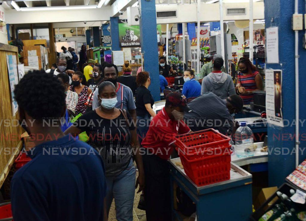 Shoppers enter Sing Chong Supermarket on Charlotte Street, Port of Spain on Tuesday. - Vidya Thurab