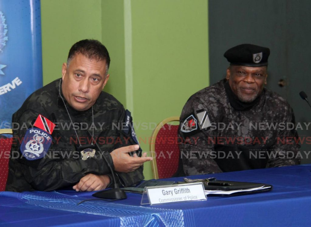 CHOSEN ONE: Police Commissioner Gary Griffith speaks during the police service's weekly media briefing at the Police Administration Building in Port of Spain on Wednesday. With him is newly-appointed head of the Special Operations Respone Team Supt Roger Alexander. - AYANNA KINSALE