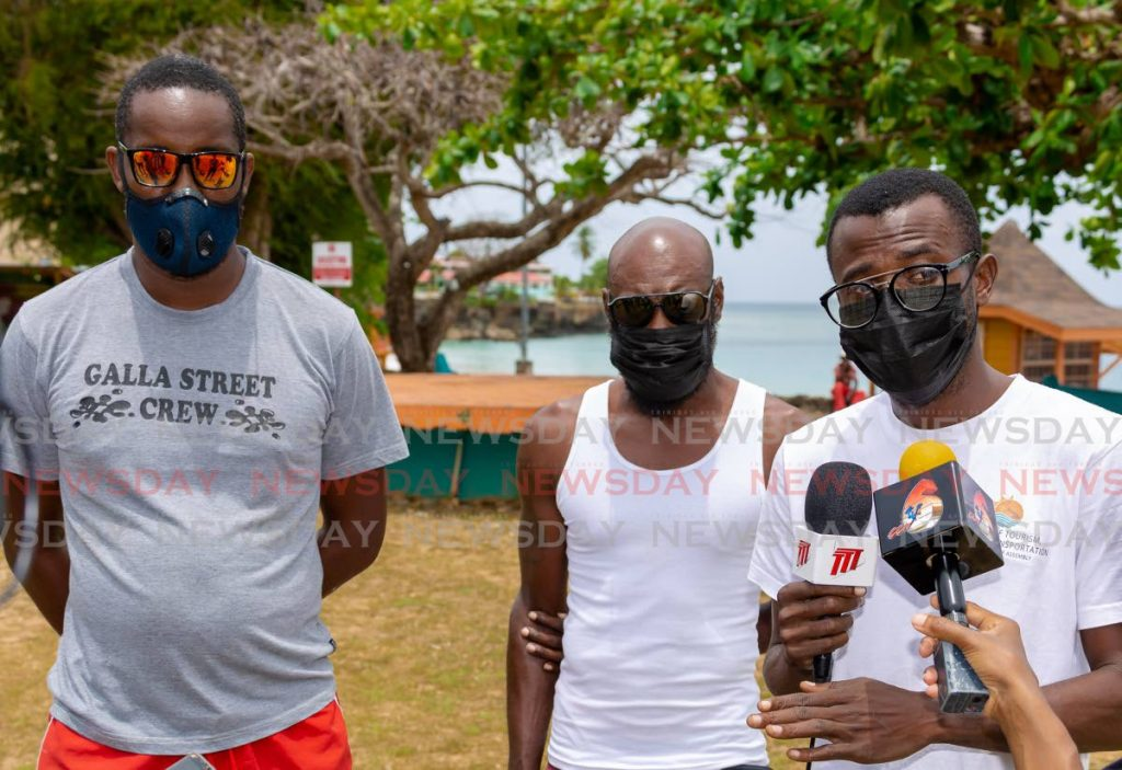 Lifeguards Cha Burris, left, and Kerry Duncan, centre,  and water and safety educator Sheldon Johnson speak to the media about their concerns at Store Bay Beach Facility on Wednesday.  - DAVID REID