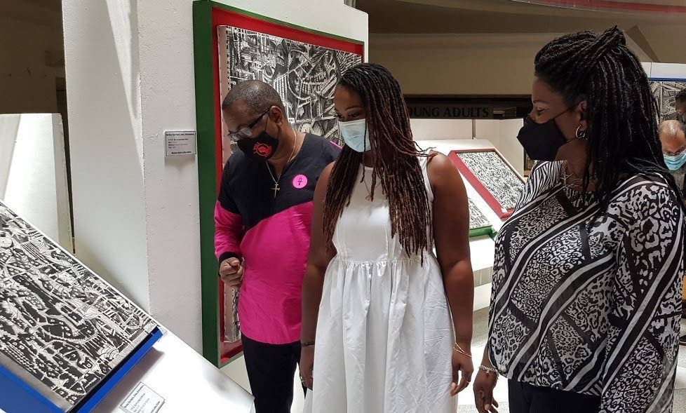 Neil Parsanlal, chairman, Nalis board, left; Adaeze Clarke, daughter of master artist LeRoy Clarke; and Paula Greene, executive director (Ag), Nalis. -