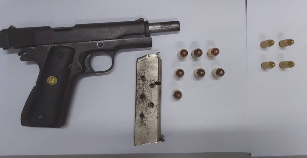 A pistol and ammunition were seized at an abandoned house on Williams Street, Laventille, early on Thursday morning.   Photo courtesy TTPS