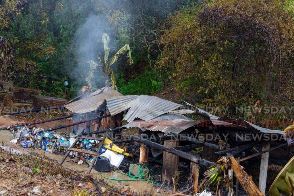 ALL GONE: The ruins of a wooden house in Scarborough, Tobago which was destroyed by fire on Wednesday. PHOTO BY DAVID REID -