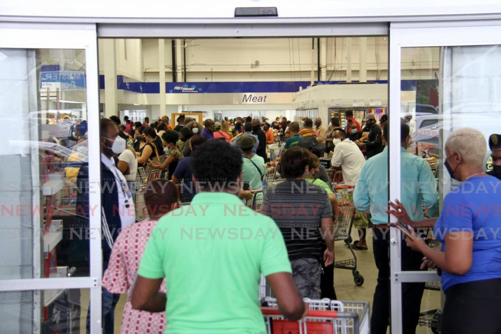MASS GATHERING: Inside Pricemart's Port of Spain branch where hundreds shopped hours after the new restrictions were announced. A smart move? What do you think? Photo by Ayanna Kinsale-