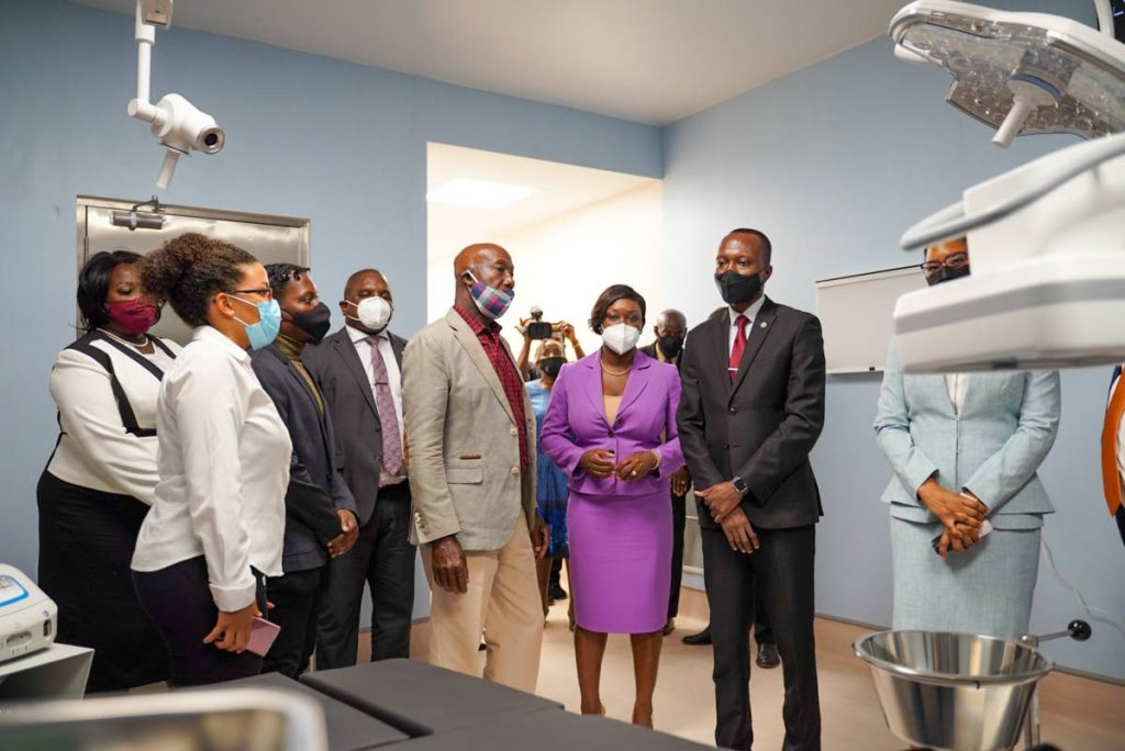 Prime Minister Dr Keith Rowley, centre, tours the Roxborough Health Facility with Chief Secretary Ancil Dennis, Health Secretary Tracy Davidson-Celestine and other officials at its commissioning in January. PHOTO COURTESY THA -