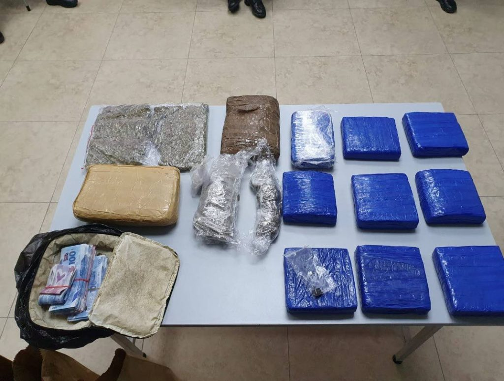 SEIZED: A quantity of marijuana, cocaine and cash seized by Port of Spain police during a pre-dawn anti-crime exercises in Sea Lots on Friday. PHOTO COURTESY TTPS - ttps