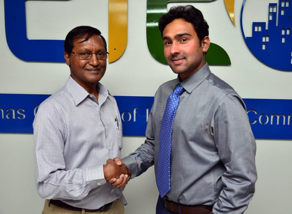 Richie Sookhai, right, congratulates Vishnu Charran who took over from Sookhai as president of the Chaguanas Chamber of Industry and Commerce (CCIC) in 2017. Sookhai has been elected president once more for the 2021 term. Photo courtesy CCIC. -