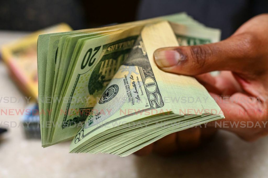 One of the ways the TT dollar could depreciate based on public behaviour is by people preferring to save their money in US dollars rather than TT dollars. - Photo by Jeff Mayers