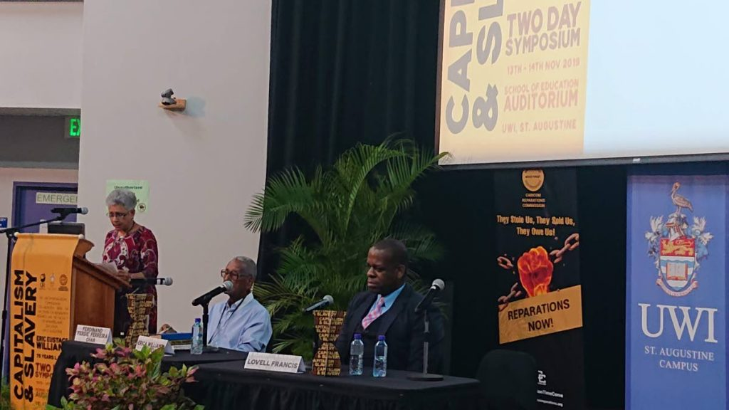 """Erica Williams-Connell addresses a symposium on the 75th anniversary of the publication of Capitalism and Slavery written by her father Dr Eric Williams at UWI, St Augustine on November 13, 2019.  PNM founding member Ferdinand """"Ferdie"""" Ferreira and Dr Lovell Francis, minister in the Ministry of Education at the time, also spoke at the event. File photo  -"""