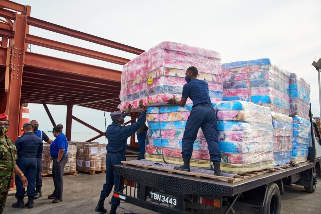 Members of the Coast Guard load mattresses onto a truck for delivery to St Vincent and the Grenadines. Photo courtesy Angostura