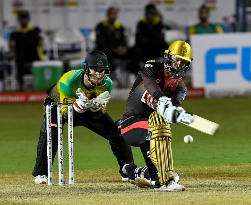 Colin Munro (R) is one of 13 Trinbago Knight Riders players retained for the 2021 Hero Caribbean Premier League T20 tournament.  - CPL T20 via Getty Images