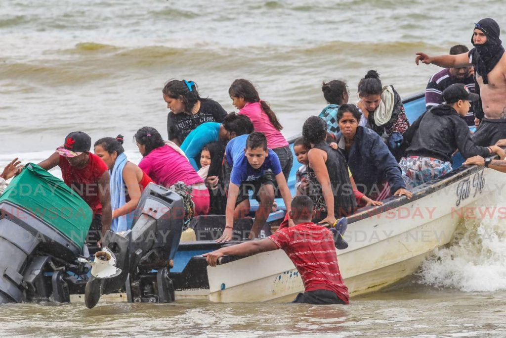 This November 2020 file photo shows people, believed to be Venezuelans, arriving at the Los Iros beach in a pirogue.  -