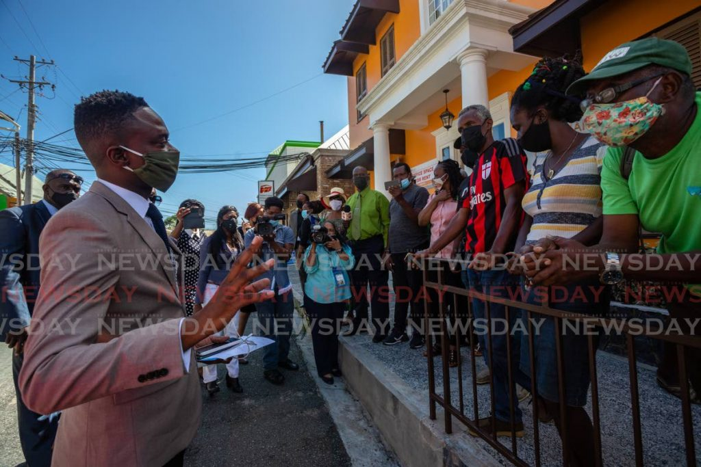 PDP deputy leader Farley Augustine, left, speaks to supporters outside the Assembly Legislature in Scarborough in January. PHOTO BY JEFF K MAYERS  -
