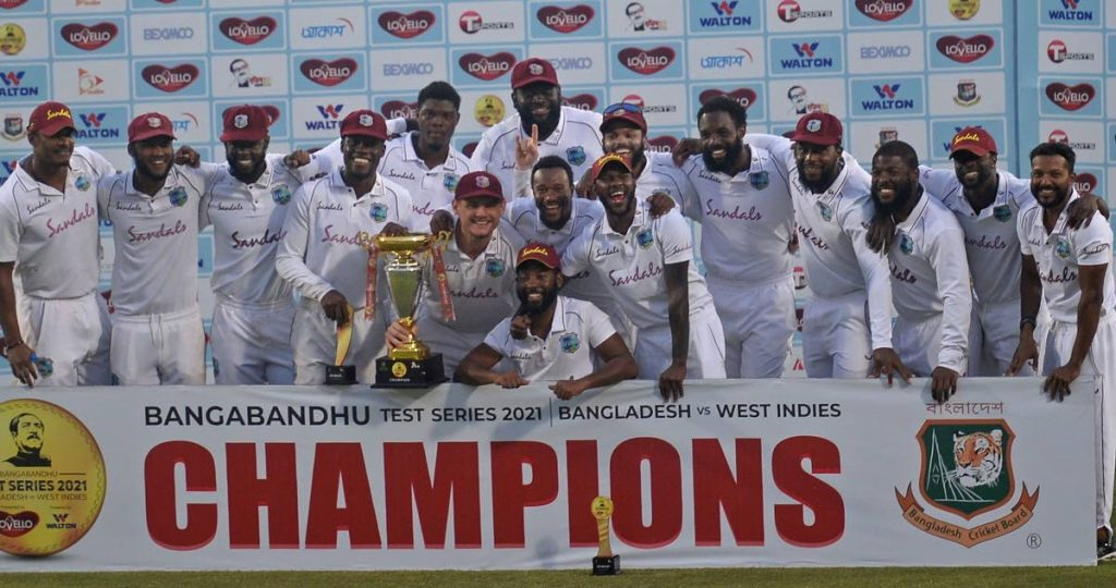 In this file photo, West Indies' players pose with the Test tournament trophy after winning the second Test cricket match against Bangladesh at the Sher-e-Bangla National Cricket Stadium in Dhaka on February 14. - CWI