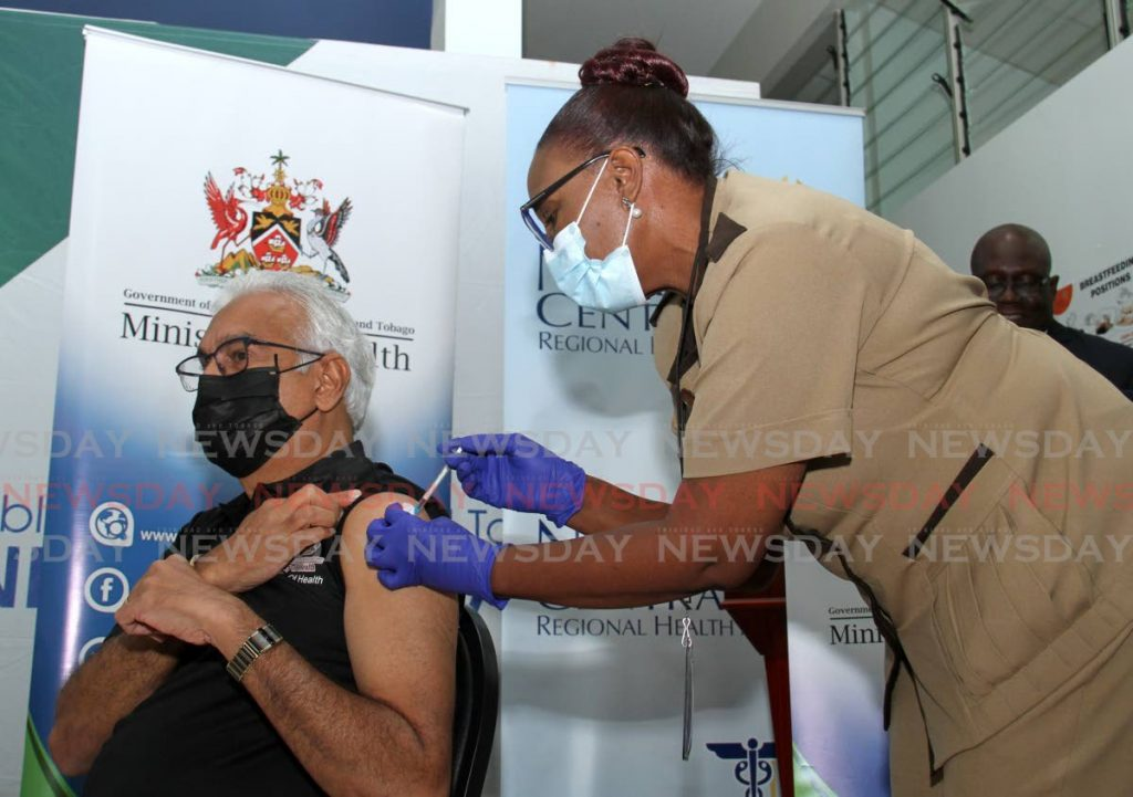 Health Minister Terrence Deyalsingh being vaccinated. - Photo by Ayanna Kinsale