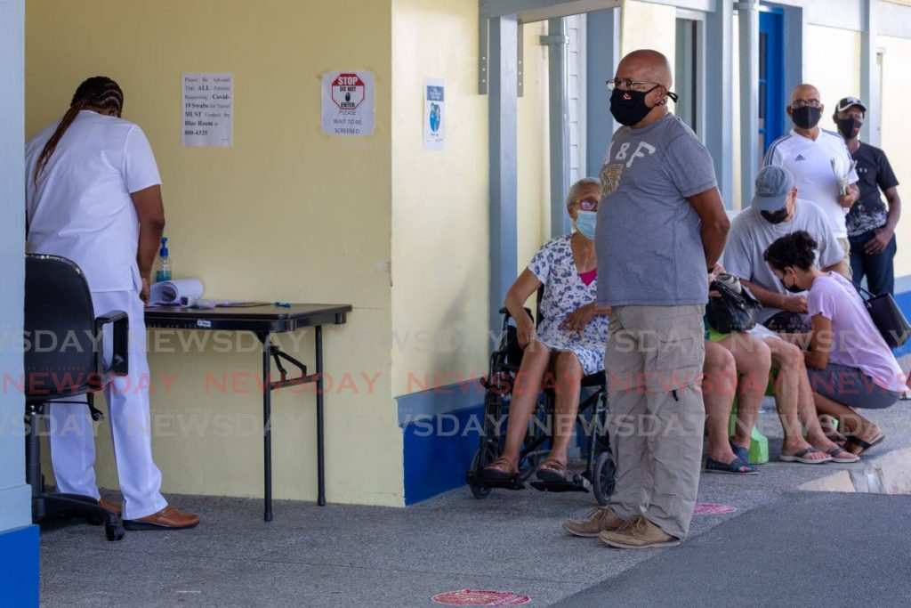 Patients outside the Canaan Health Centre during the vaccination drive in Tobago. - David Reid