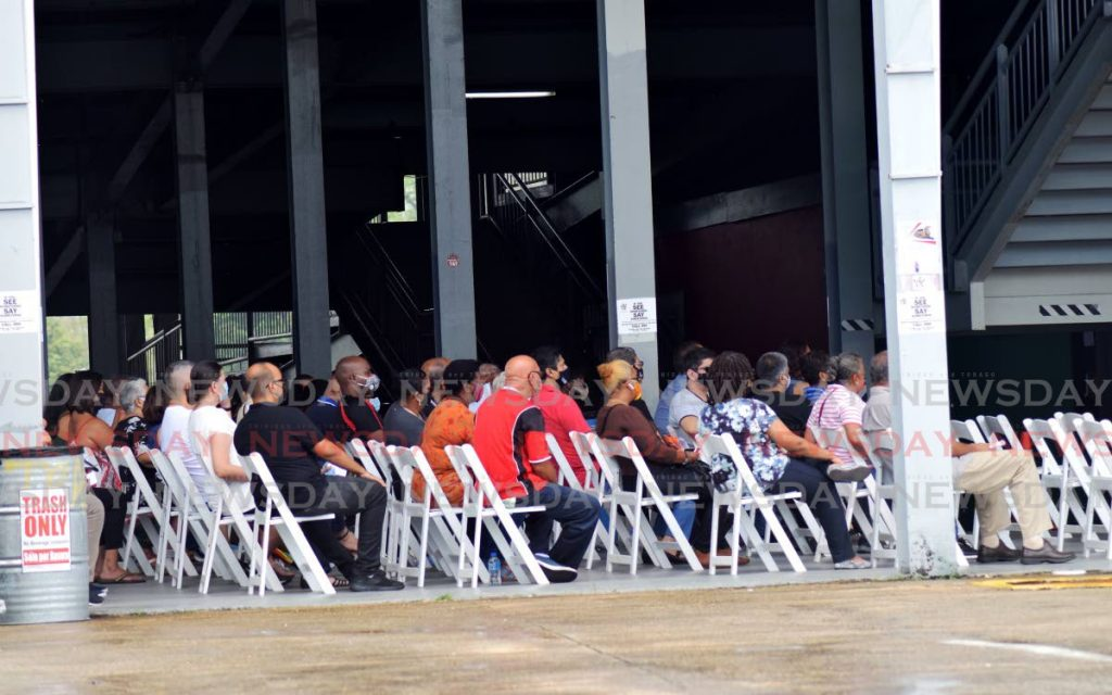 In this photo taken on April 24, people wait to get their covid19 vaccination at the Queen's Park Savannah, Port of Spain. Can employers seek to make vaccination mandatory? - Vidya Thurab