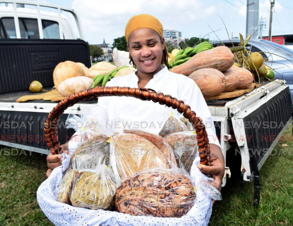 Ibu Kemi with a basket of assorted breads at Namdevco Farmers Market, Queen's Park Savannah, Port of Spain. - Photo by Vidya Thurab