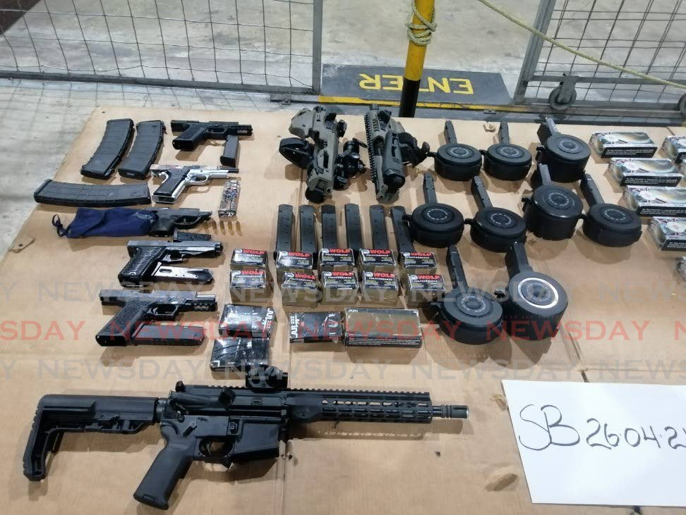 Guns and ammunition seized by police. -