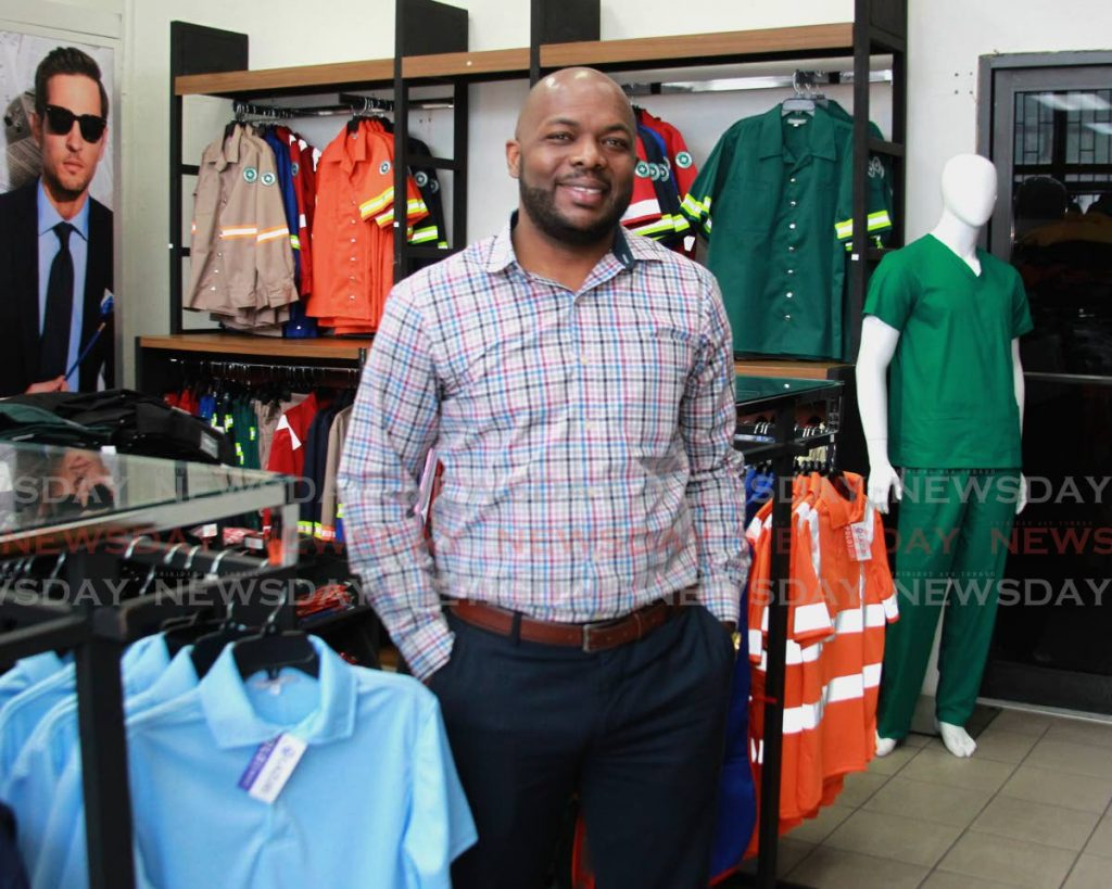 Ronald Roach in a showroom with PPE garments such as scrubs, industrial and safety garments which Lazuri Apparel now manufacturers.  PHOTO BY ROGER JACOB