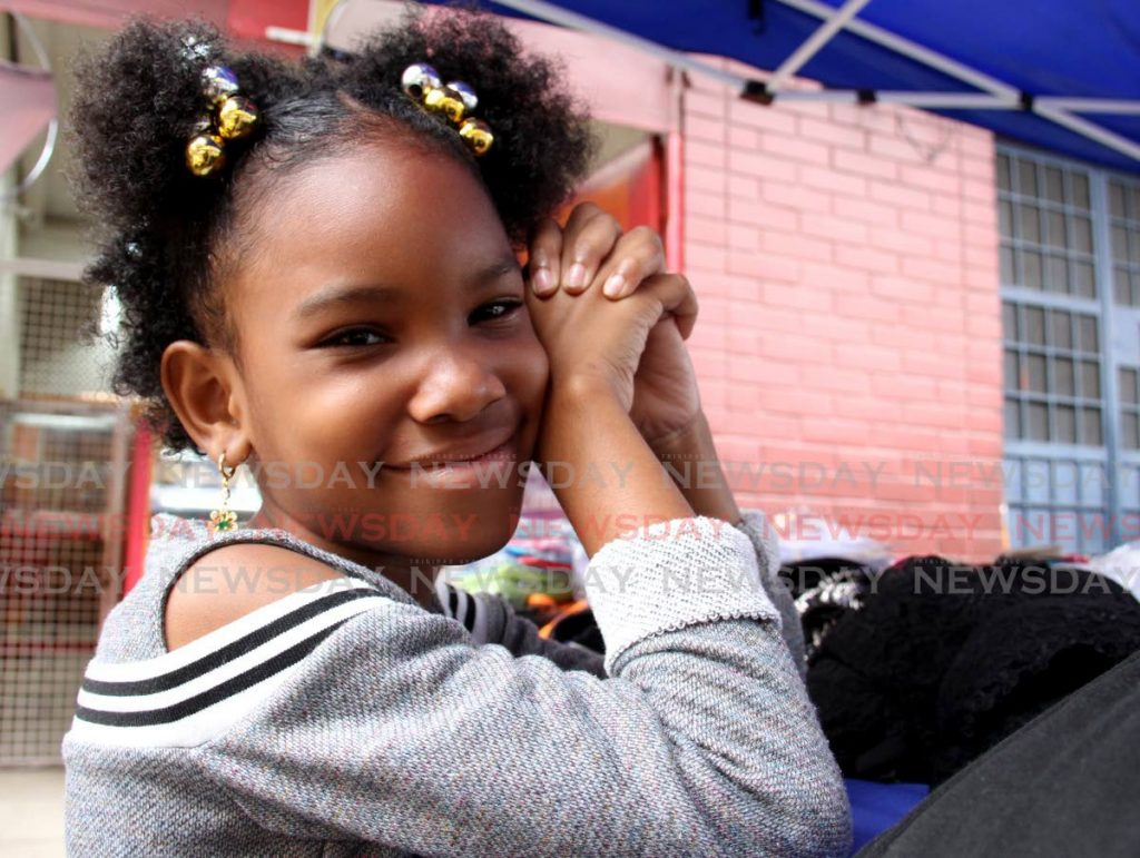 Nyima Boucaud enjoys meeting people at her mother's stall in Port of Spain. - PHOTO BY AYANNA KINSALE