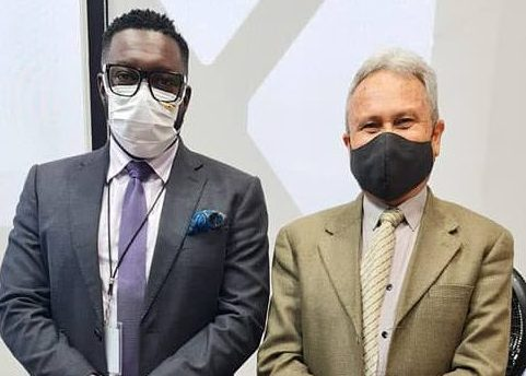 This photo, posted to the Facebook page of Watson Duke, shows the PSA leader, at left, standing next to Finance Minister Colm Imbert following their meeting on Friday at Imbert's office.  -