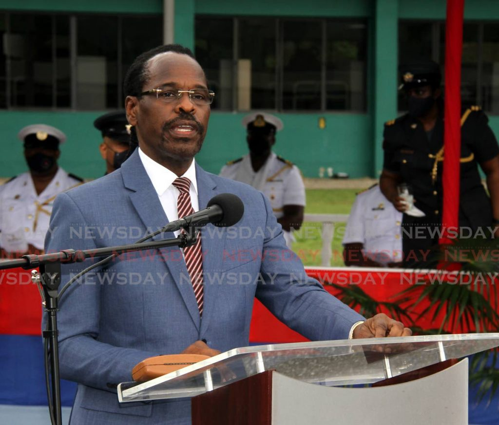 Minister of National Security Fitzgerald Hinds, gives the feature address at the TTDF joint recruit passing out parade, at Teteron Barracks in Chaguaramas on Monday. - Photo by Angelo Marcelle