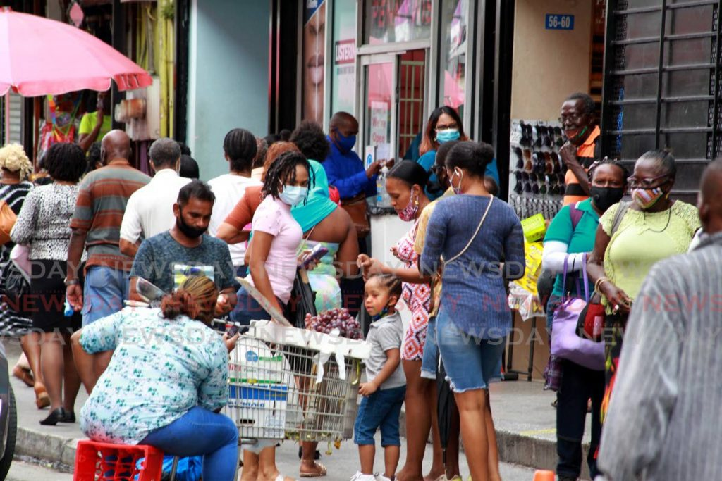 Shoppers on Charlotte Street, Port of Spain, on Monday. Photo by Roger Jacob