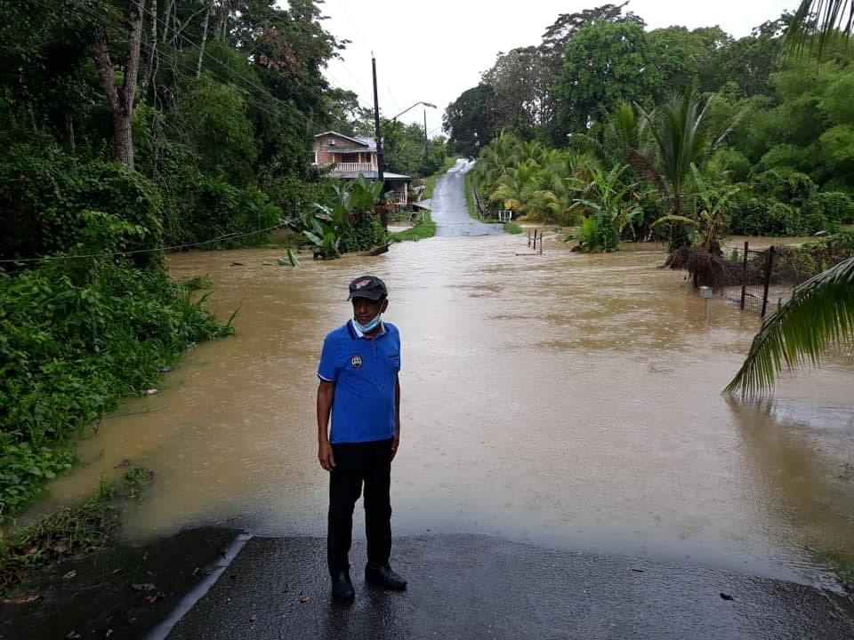 Rio Claro North councillor Hazarie Ramdeen assessing the areas flooded after heavy rain on Tuesday. Photo via Facebook.  -