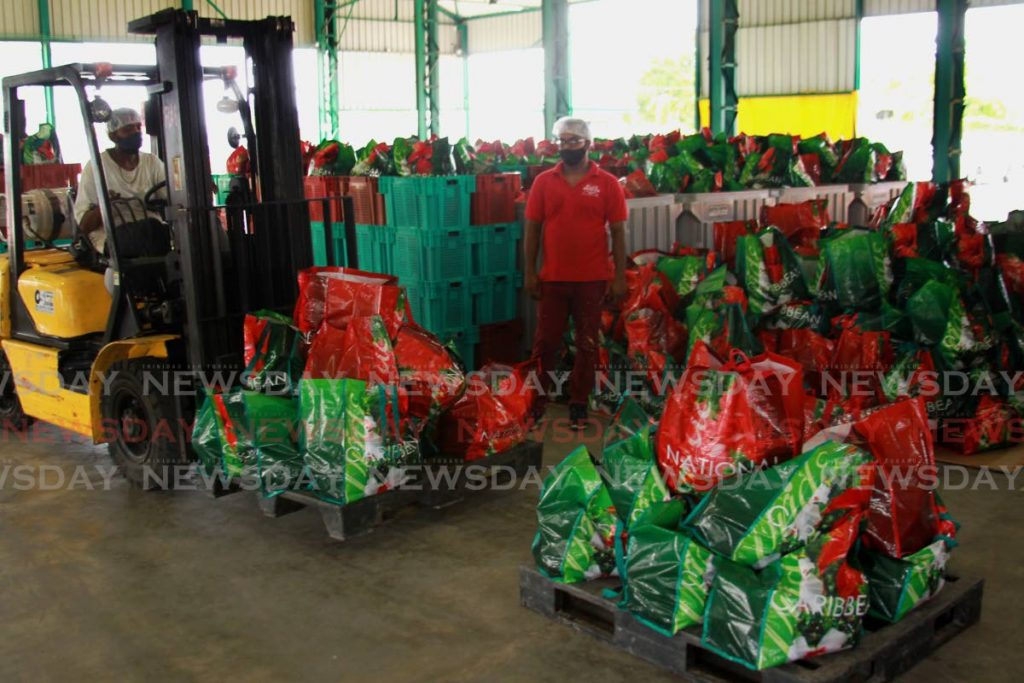 A forklift operator moves packaged food baskets at Namdevco's Woodford Lodge, Chaguanas warehouse. Photo by Roger Jacob -
