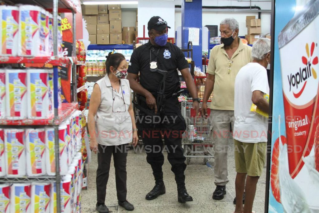 File photo: Supt Glen Charles of the Port of Spain Municipal Police as he met with supermarket owners  to ensure that stores, shoppers and vendors adhere to covid19 protocol.