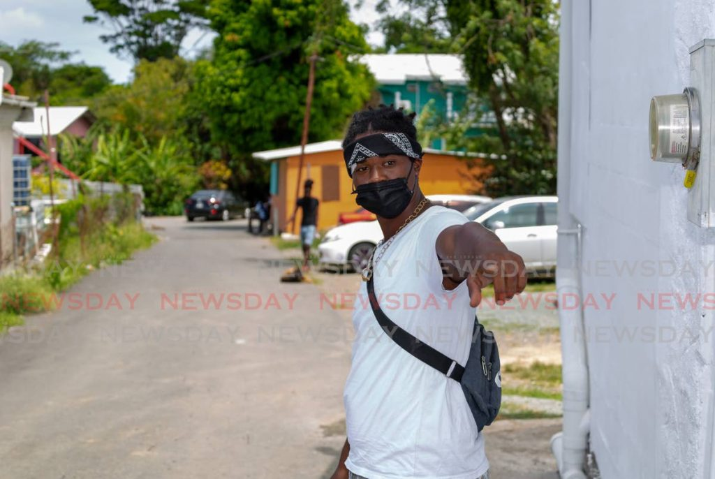 Jamal Cordner shows media where they police came from while recalling how his brother got shot by police in Signal Hill on Tuesday evening. Photo by David Reid