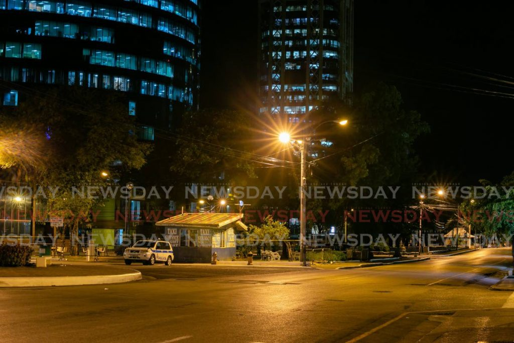 Street lamps and lights from offices of Nicholas Tower and one of the towers of the Central Bank illuminate the Brian Lara Promenade, Port of Spain, at 10.20 pm on Sunday. - Photo by Jeff Mayers