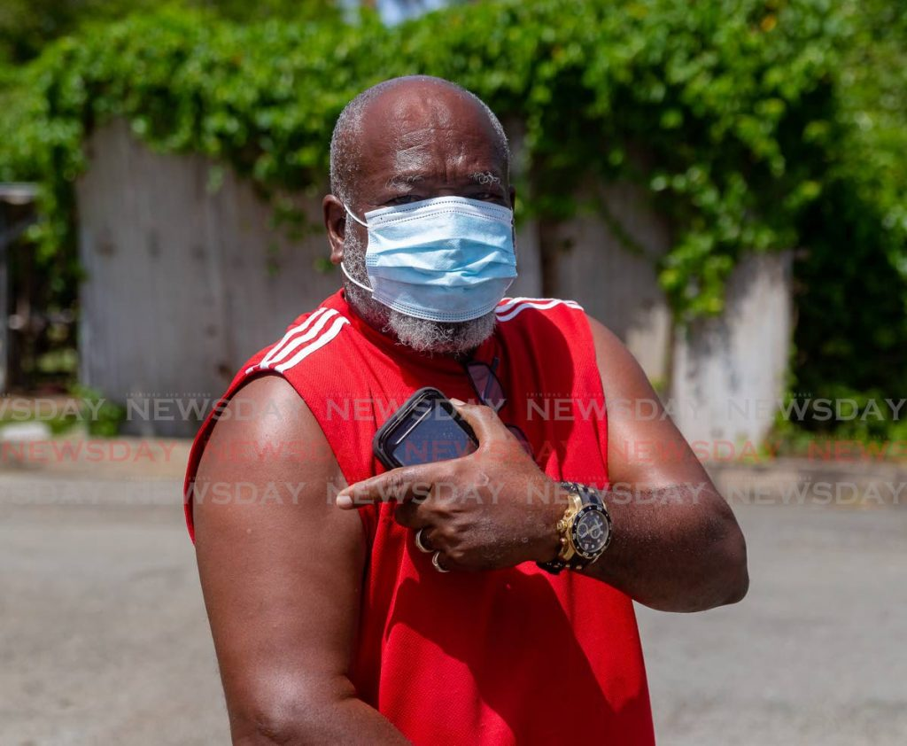 Donald Miggins shows his arm after receiving his covid19 vaccine shot at Canaan Health Centre on Monday. PHOTO BY DAVID REID  -