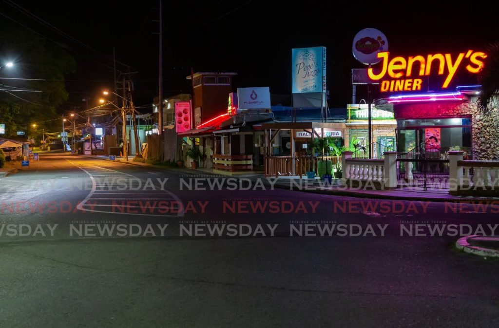 The popular Crown Point food stretch on Milford Road is deserted at night. Photo by David Reid