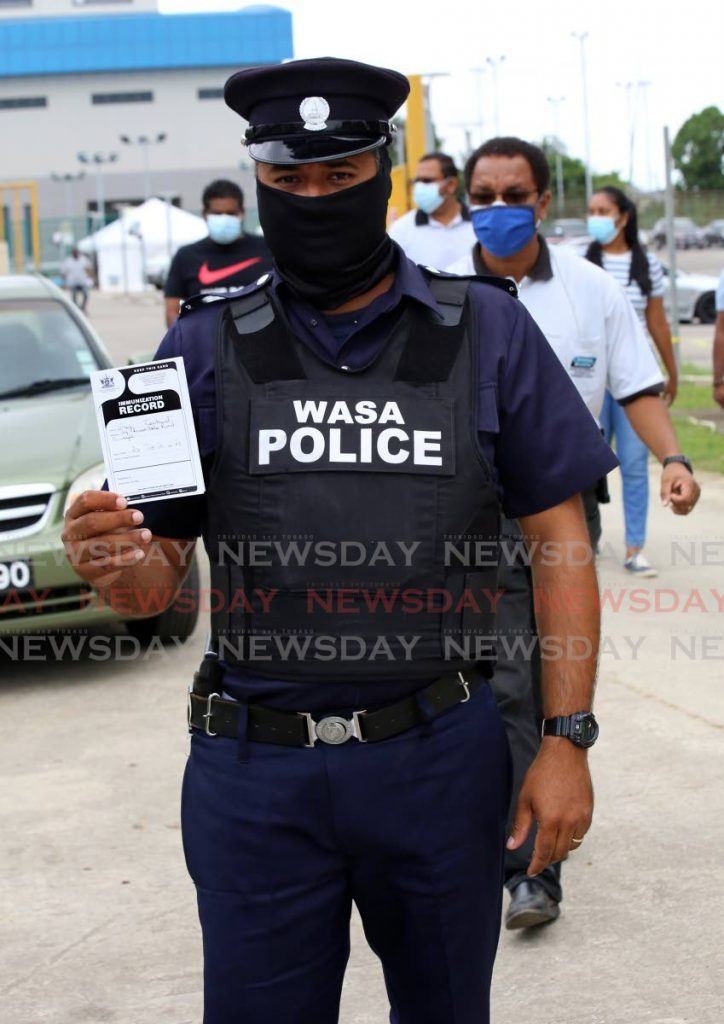 WASA police officer Greg Leotaud was among the public utilities employees who received their covid19  vaccine at the National Racquet Centre Orange Grove Rd, Tacarigua, on Tuesday.  - SUREASH CHOLAI