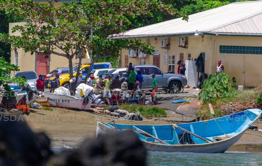 Police officers at Belle Garden, Tobago where the boat with 14 bodies was dragged ashore. - Photo by David Reid