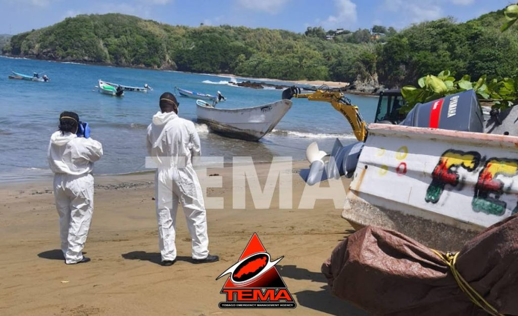 A crane is used to pull the boat ashore at Clarke's Bay, Bell Garden on Friday. - PHOTO COURTESY THE TOBAGO EMERGENCY MANAGEMENT AGENCY