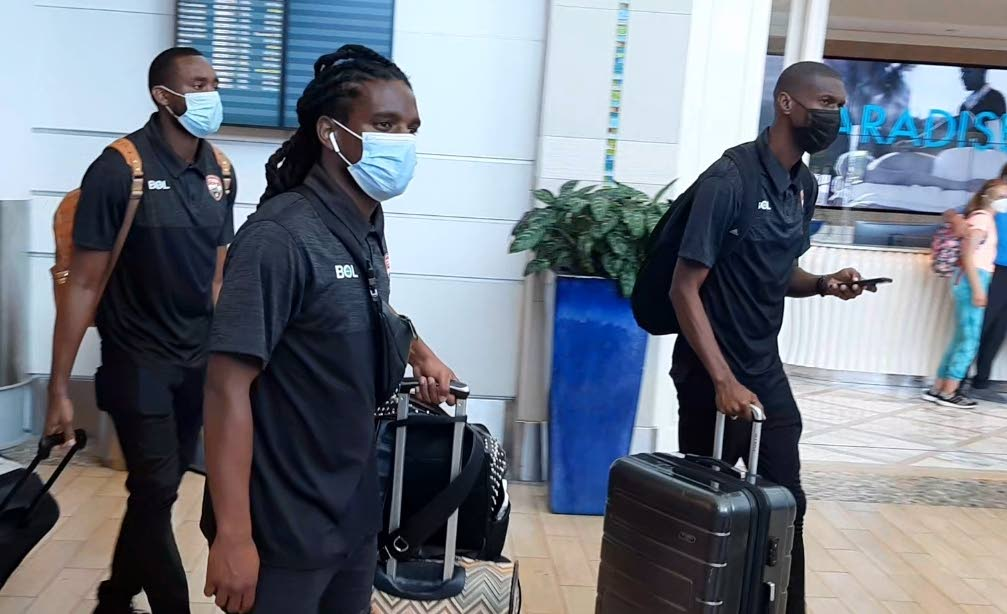 TT midfielder Duane Muckette (centre) upon the team's arrival in the Bahamas on Saturday. PHOTO COURTESY TT FOOTBALL ASSOCIATION. -