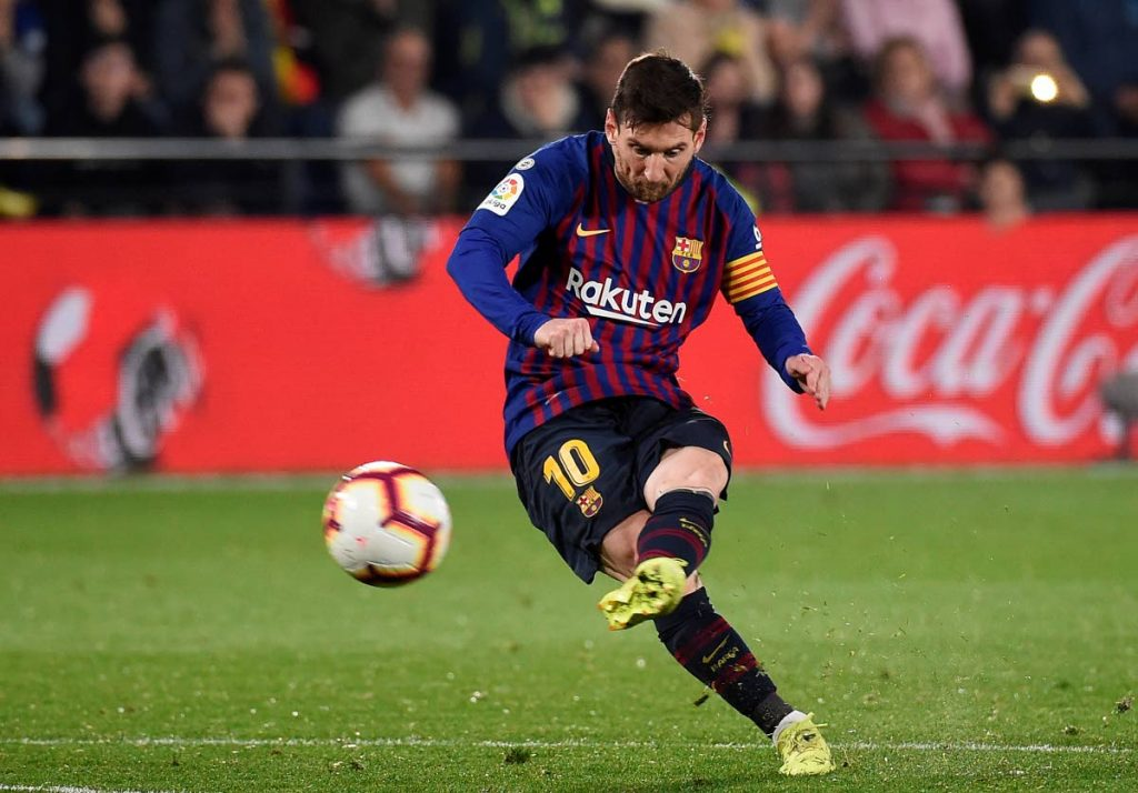 In this April 2, 2019 file photo, Barcelona's Argentinian forward and one of the world's top footballers Lionel Messi scores during the Spanish league football match against Villarreal CF at La Ceramica stadium in Vila-real.  AFP PHOTO -