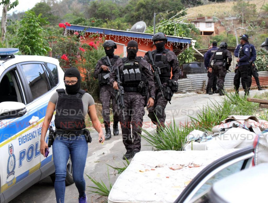 File photo: Members of the Special Operations Response Team at the scence where three people were shot dead by officers assigned to the unit in Santa Cruz in April 2020. -