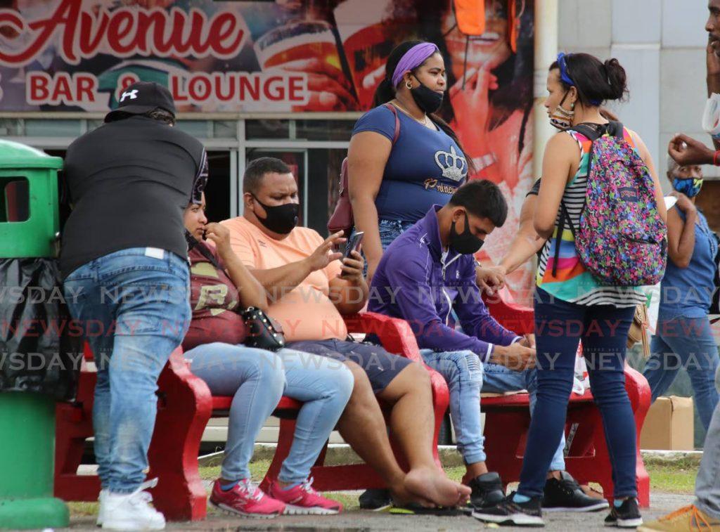 A group of Venezuelan immigrants on the Brian Lara Promenade in Port of Spain. Photo by Sureash Cholai - SUREASH CHOLAI