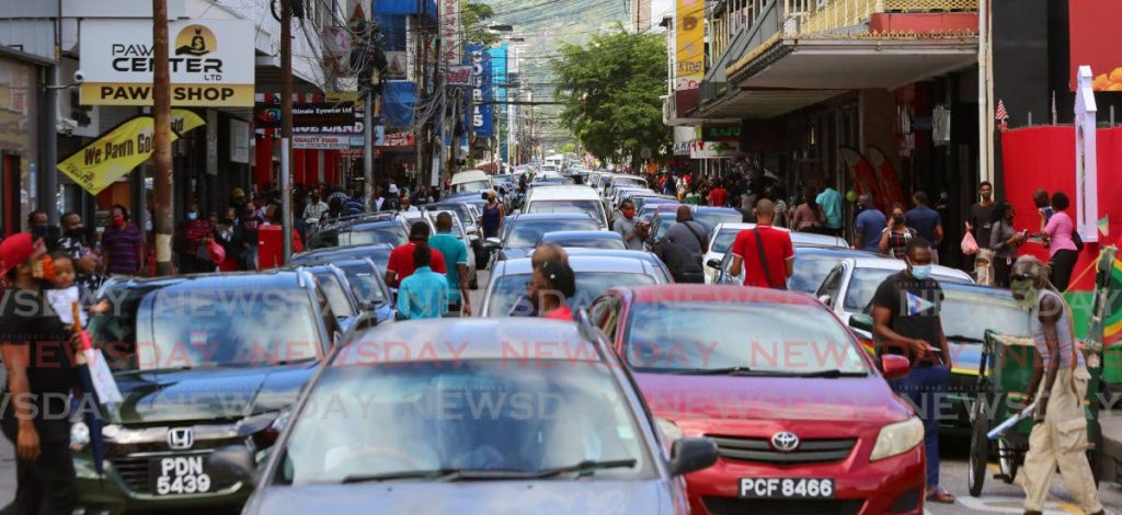 In this file photo, Frederick Street in Port of Spain is packed with pedestrians and cars as people go about their business. Employers may find a shift in working practices when businesses are allowed to reopen. - SUREASH CHOLAI