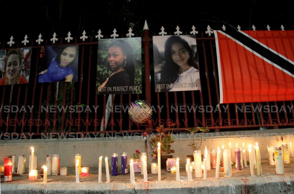 FILE PHOTO: Candles and flowers were laid on the pavement  opposite the Red House on Abercromby Street, Port of Spain, for Ashanti Riley, Andrea Bharatt and other victims who lost their lives to gender-based violence during a candlelight vigil on February 8.  -