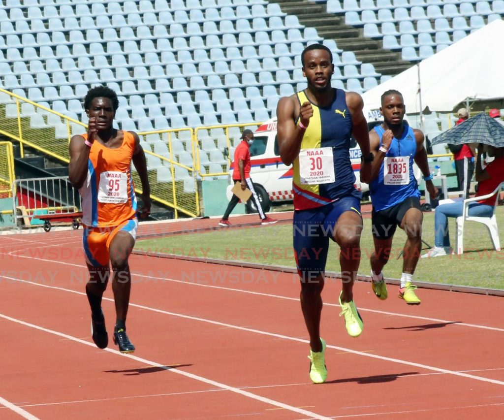 In this file photo, Jonathan Farinha (C) takes part in a mens 100m race at a NAAA track and field event, - Photo by Sureash Cholai
