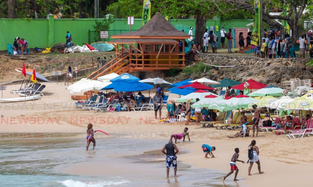 In this file photo, people relax at Store Bay Beach in Tobago. - David Reid