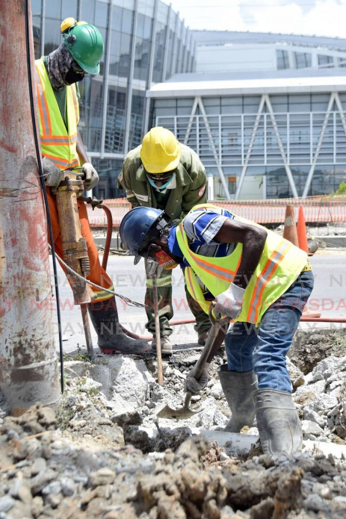 In this April file photo, workers excavate around a utility pole on the corner of Gulf View Link Road, San Fernando. Should the right to gainful employment not be acknowledged as a basic human right? -