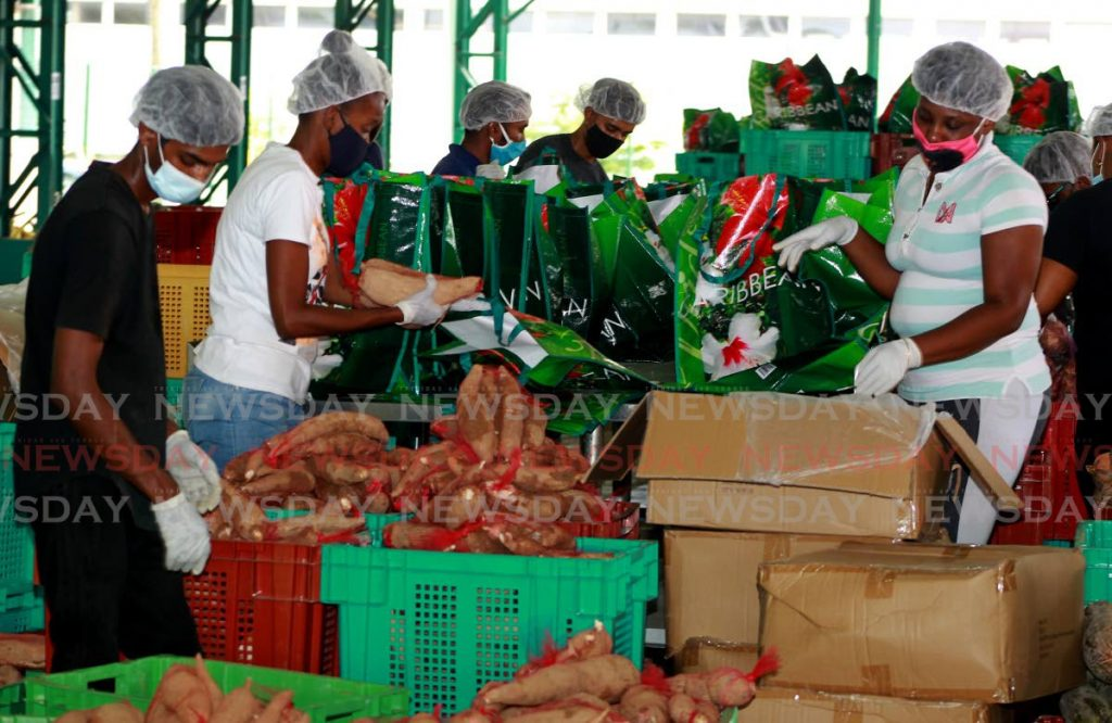 FILE PHOTO: Workers at the Woodford Lounge Packing Warehouse in Chaguanas prepare fruits and vegetables for pandemic relief hampers to needy families on May 11. -