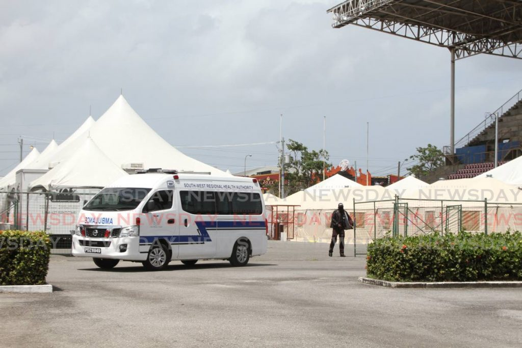 Am ambulance exits the field hospital set up at the Jean Pierre Complex, in Port of Spain last month. - Marvin Hamilton